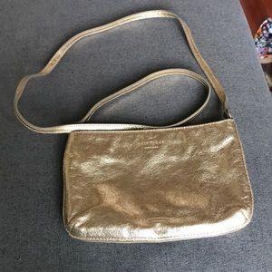 Gold kate Spade crossbody bag